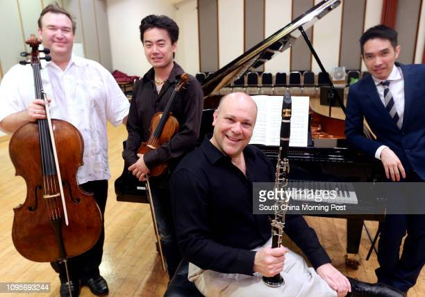 Group portrait of HK Phil musicians Richard Bamping Concertmaster Jing Wang Andrew Simon and pianist Warren Lee who are joining forces for a May...