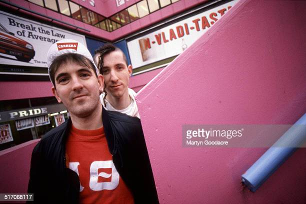 Group portrait of indie rock duo Carter the Unstoppable Sex Machine at Elephant and Castle shopping centre, London, 1991. Les 'Fruitbat' Carter, Jim...
