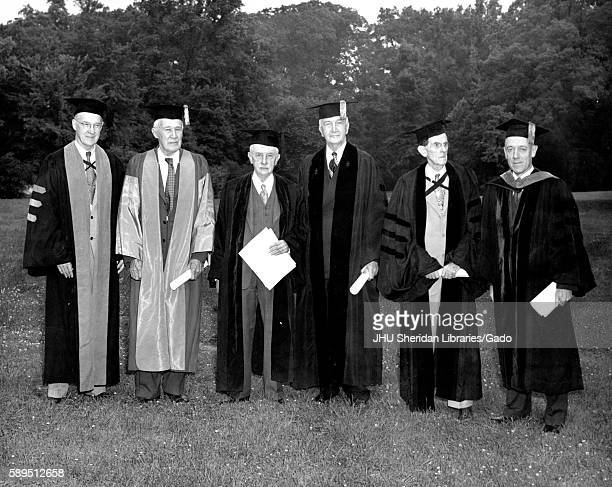 Group portrait of Johns Hopkins University President and honorary degree recipients in academic dress following the University's class of 1951...