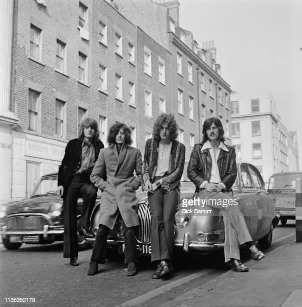 Group portrait of Led Zeppelin leaning against a Jaguar car in a London street, December 1968. L-R: John Paul Jones, Jimmy Page, Robert Plant, John...