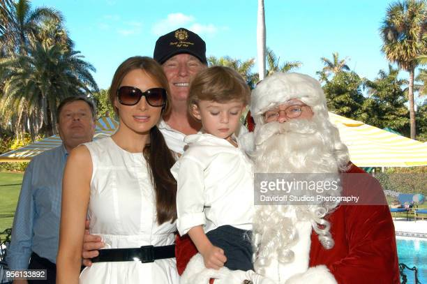 Group portrait of left to right Viktor Knavs Melania Trump Donald Trump Barron Trump and Santa Claus on Christmas Day at the MaraLago estate in Palm...