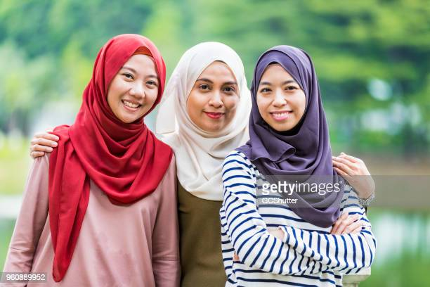 group portrait of malaysian girls wearing hijab - malaysia beautiful girl stock photos and pictures