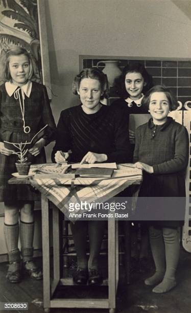 Group portrait of Martha Berg teacher Miss Gordon Anne Frank and Rela Solomon in a classroom at a Montessori school Taken from Anne's photo album...