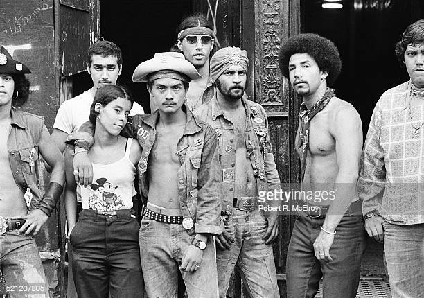 Group portrait of members of Bronz street gang the Dragons as they stand toegther on a sidewalk New York New York 1975