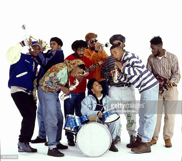 Group portrait of members of the Native Tongues Posse rap collective as they clown around with toy instruments New York New York 1990 Among those...