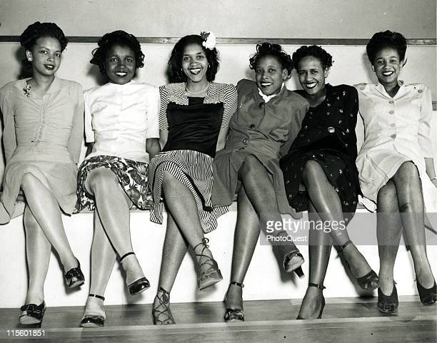 Group portrait of pinup girls smiling while attending the Spring Formal Dance at the Naval Air Station in Seattle WA April 1944