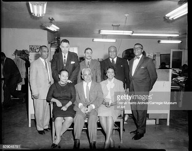 Group portrait of Pittsburgh Courier newspaper employees seated from left Hazel Garland John Clark Willa Mae Rice standing Charles 'Teenie' Harris...