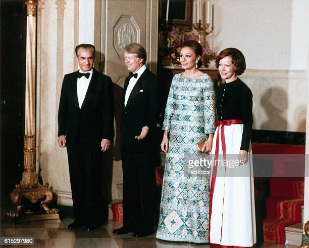 A group portrait of President and Rosalynn Carter with the Shah and Shahbanou of Iran during a state dinner in the White House ca 1977