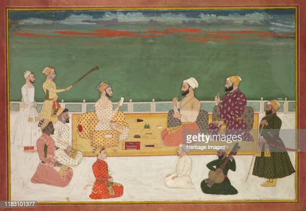 Group Portrait of Rajas Surrounded by the Courtly Retinue circa 170020 This large and rare painting represents a southern Indian genre of portraiture...