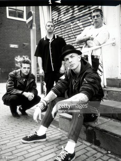Group portrait of Rancid in Amsterdam Netherlands 1995 LR Brett Reed Matt Freeman Tim Armstrong Lars Frederiksen