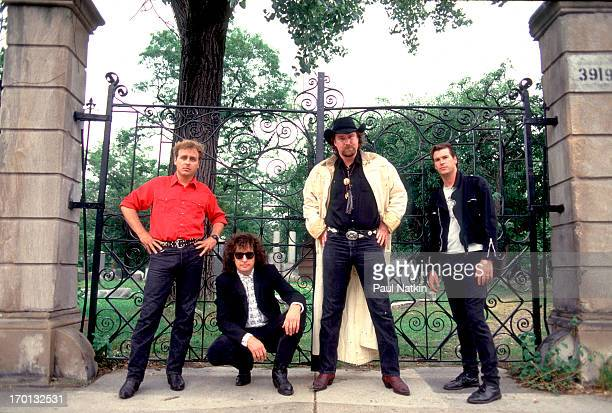 Group portrait of rock band the Beat Farmers as they pose in front of an iron gate Chicago Illinois September 17 1987 Pictured are from left Joey...