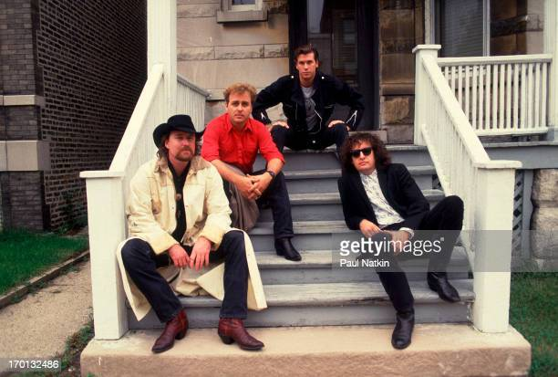 Group portrait of rock band the Beat Farmers as they pose on porch stairs Chicago Illinois September 17 1987 Pictured are from left Country Dick...