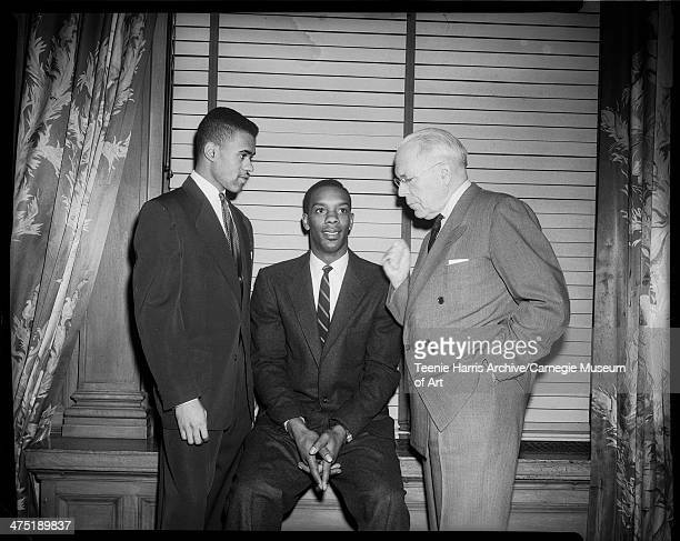 Group portrait of runner Arnold 'Arnie' Sowell basketball player Sihugo 'Si' Green and Pittsburgh Mayor David L Lawrence at Dapper Dan banquet...