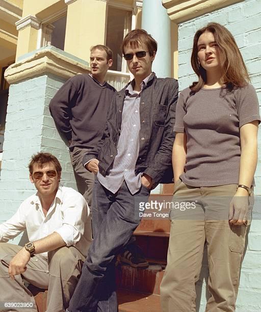 Group portrait of Scottish indie rock band The Delgados, London, August 2000. L-R Stewart Henderson, Paul Savage, Alun Woodward, Emma Pollock.