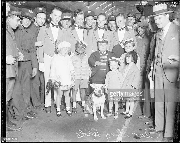 Group portrait of six child actors from the 'Our Gang' comedy series standing in a railroad station in Chicago Illinois 1928 One of the actors is...