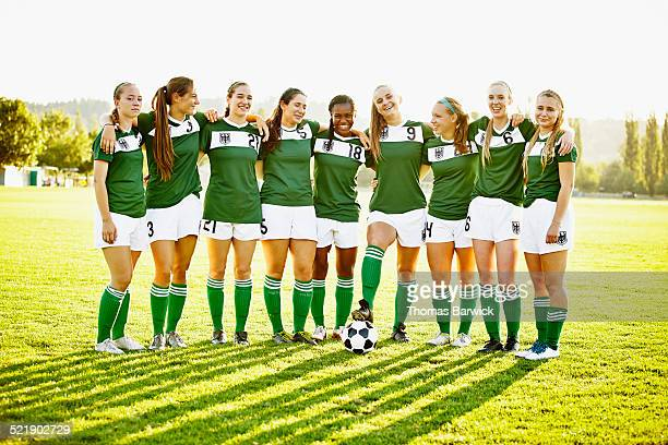 group portrait of smiling female soccer team - soccer team stock pictures, royalty-free photos & images