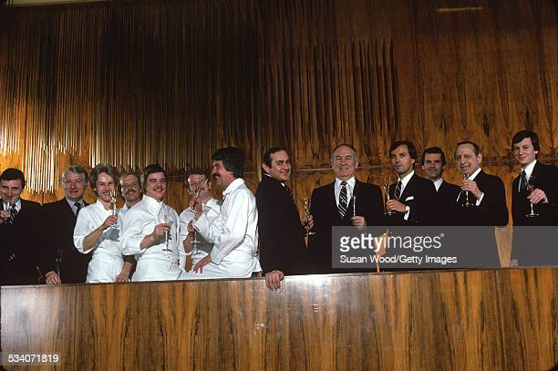Group portrait of some of the staff of the Four Seasons Hotel as they raise glasses of champagne New York New York February 1982