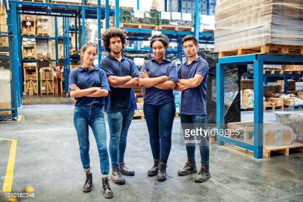 group portrait of staff at distribution warehouse - four people stock pictures, royalty-free photos & images