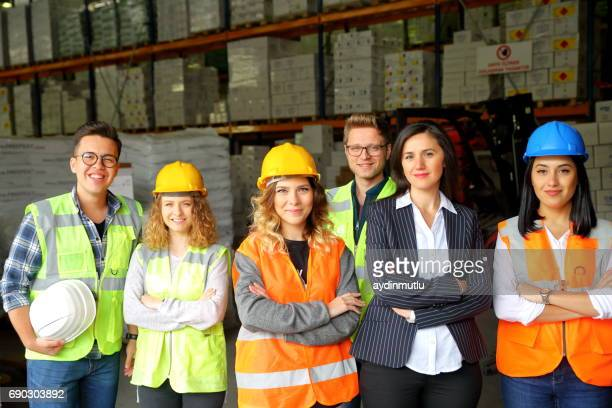 Group portrait of staff at distribution warehouse