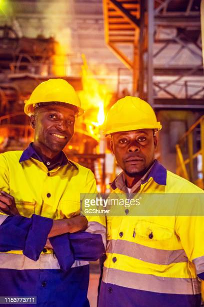 group portrait of steel factory workers in africa - steelmaking stock photos and pictures