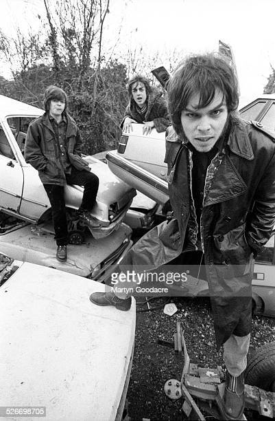 Group portrait of Supergrass on a scrapyard near Oxford United Kingdom 1996 LR Mick Quinn Danny Goffey and Gaz Coombes