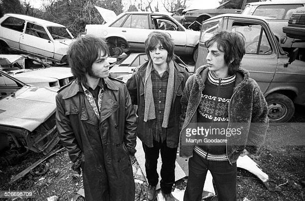 Group portrait of Supergrass on a scrapyard near Oxford United Kingdom 1996 LR Gaz Coombes Mick Quinn and Danny Goffey