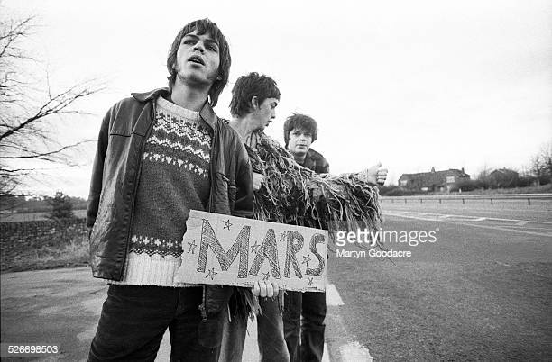 Group portrait of Supergrass trying to hitch a lift to Mars by the side of a road near Oxford, United Kingdom, 1994. L-R Gaz Coombes, Danny Goffey...