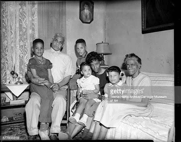 Group portrait of surviving family members of car accident victim James Smith including wife Doris Smith in center holding daughter Patrice daughter...