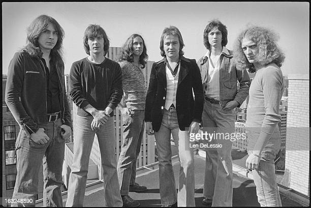 Group portrait of the British American rock band Foreigner as they pose together on a rooftop New York New York 1976 Pictured are from left American...