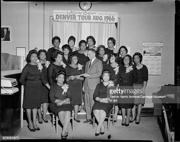 Group portrait of the Gould Singers seated from left Naomi Porter Carrie Green standing first row Ethel Kindred Lois Francis Ruby Gould presenting...