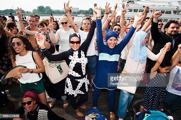 A group portrait of the people gathered in Antwerp at the beach party to protest against the ban of Burkini's in France