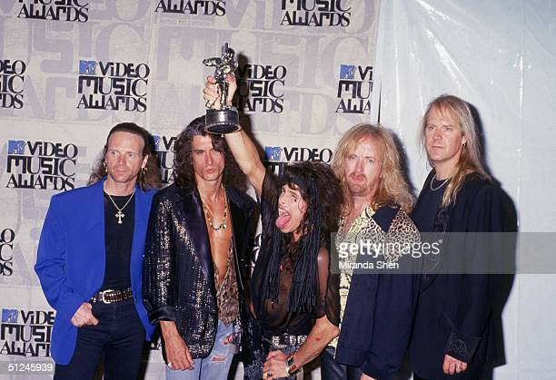 1993 Group portrait of the rock band Aerosmith at the MTV Video Music Awards 1993 Left to right drummer Joey Kramer lead guitarist Joe Perry vocalist...