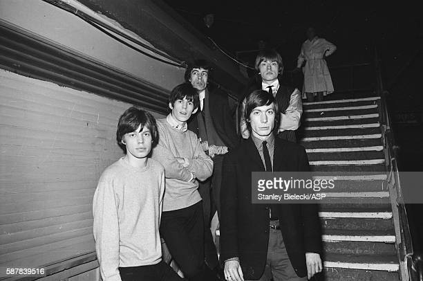 Group portrait of The Rolling Stones backstage at the Fourth National Richmond Jazz Blues Festival United Kingdom 7th August 1964 LR Mick Jagger...