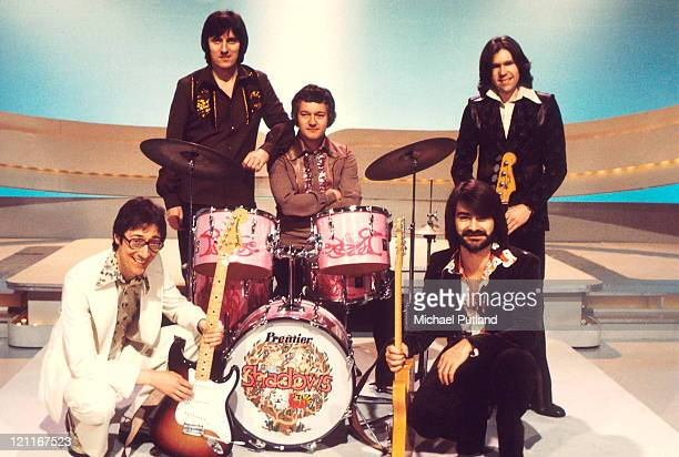 Group portrait of The Shadows on teh set of a TV show London LR Hank Marvin Bruce Welch Brian Bennett John Farrar Alan Tarney