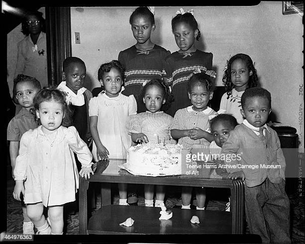 Group portrait of three boys and eight girls gathered in home of Thomas R Ficklin and family 268 Paulson Avenue Pittsburgh Pennsylvania June 1945...