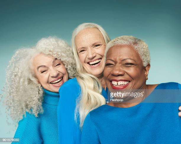 group portrait of three mature women smiling - three people fotografías e imágenes de stock