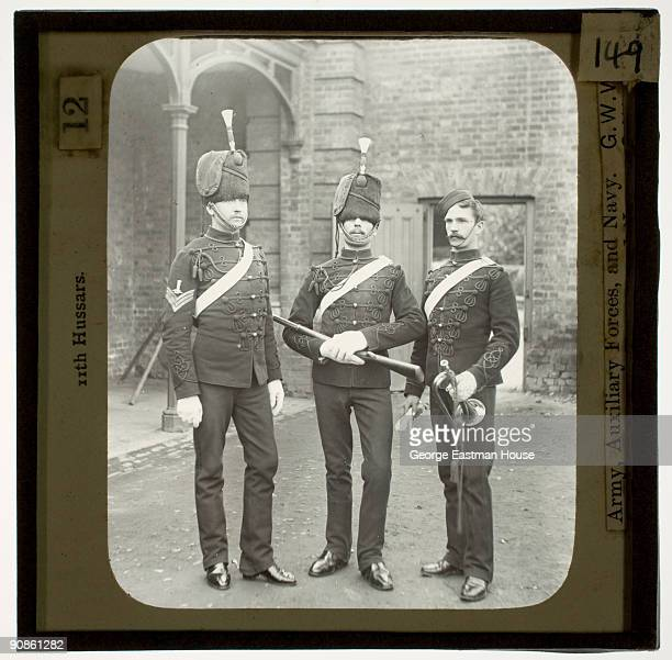Group portrait of three members of the 11th Hussars a cavalry regiment of the British army ca1880s
