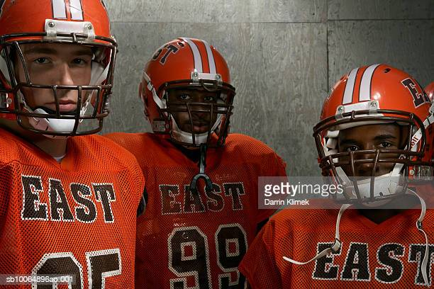 group portrait of three teenage (16-18) american football players - safety american football player stock pictures, royalty-free photos & images