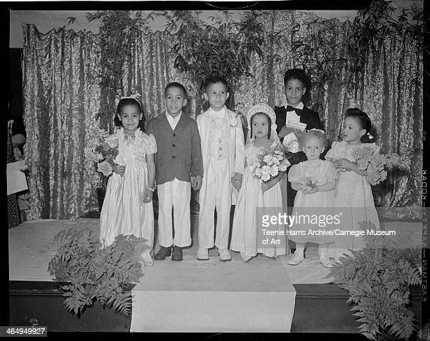 Group portrait of Tom Thumb wedding posed in Brown Chapel Church for Novelty Fashion Revue Pittsburgh Pennsylvania April 1945 From left Verdeen...