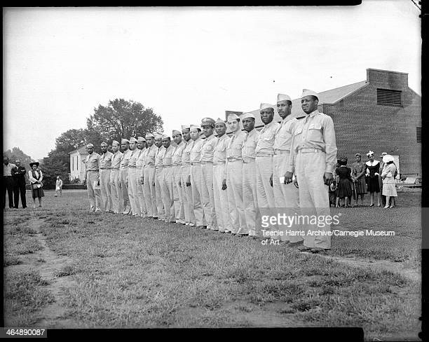 Group portrait of US Army doctors, standing in line at Field Service school at Carlisle Barracks, Carlisle, Pennsylvania, 1942. From left: James D...