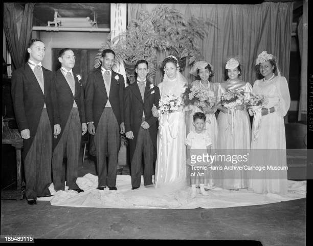 Group portrait of wedding party posed in Clark Memorial Baptist Church Homestead Pennsylvania January 1941 From left Robert Lavelle James Goode best...