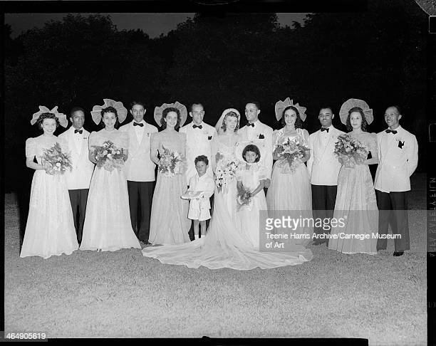 Group portrait of wedding party with six women including bride Adah Moore Lavelle Rosalind Lindsay Romaine Denning Geraldine Burgia Euzzy Mahoney...