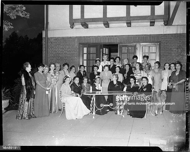 Group portrait of women in evening wear gathered on patio of Vann estate Pittsburgh Pennsylvania 1944 Seated from left Lacy Doss Mrs DW Byrd Ella...