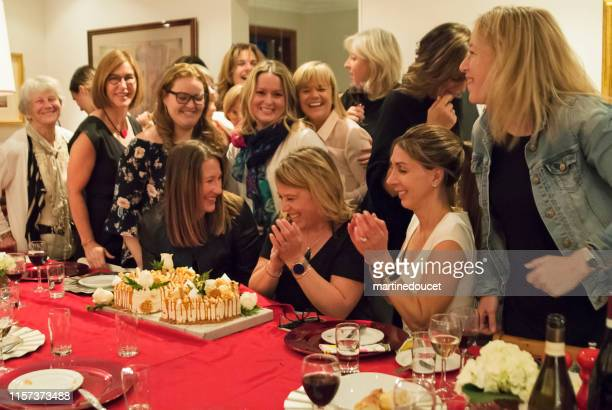 Group portrait of women of all generations celebrating birthday.