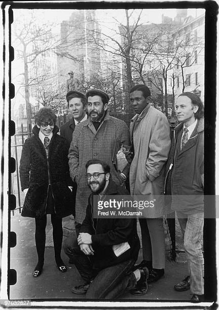 Group portrait of writers for the Village Voice newspaper as thet pose in Sheridan Square Park near the paper's offices New York New York December 21...