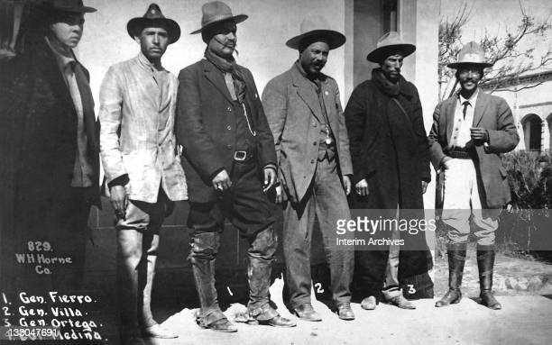Group portrait showing Mexican Revolutionary General Pancho Villa standing third from right with his generals and officers 1913 To Villa's right...