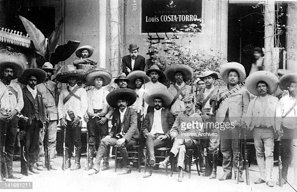 Group portrait showing Mexican revolutionary leader Emiliano Zapata seated in center among his men early twentieth century