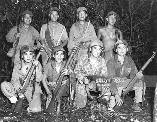 Group portrait showing Navajo Indians skilled in the native lore of their ancestors who are serving with a Marine Signal Unit in Bougainville during...