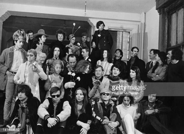 Group portrait taken at Andy Warhol's Factory in honor of the publication of 'Silver Flower Koo' a book of poetry by Charles Henri Ford New York New...