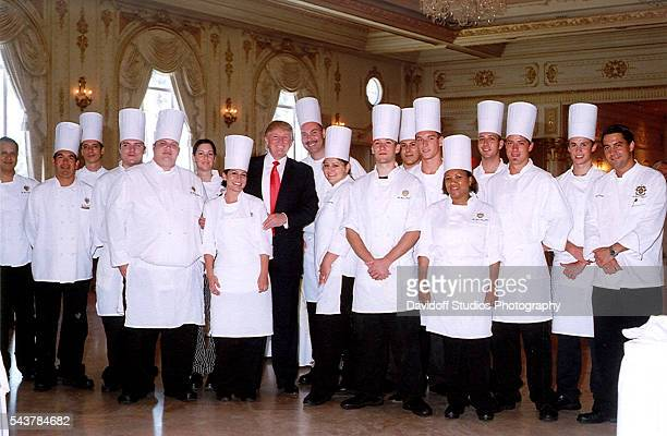 Group portrait the cooks and kitchen staff of the MaraLago estate as they pose with businessman Donald Trump on Mother's Day Palm Beach Florida May...